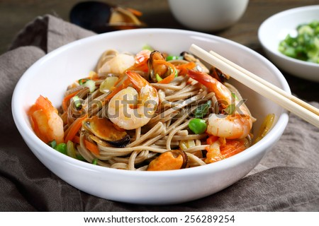noodles with shrimp and mussels, food, horizontal composition - stock photo