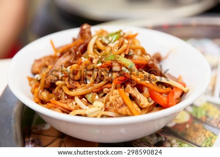 Noodles with soy sprouts and vegetables cooked in wok, typical asian food - stock photo