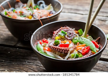 Noodles with vegetables and seafood - stock photo