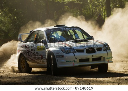 NOOJEE - NOVEMBER 11, 2011: Simon and Sue Evans on their way to an outright 1st at Rally VIctoria, November 11, 2011, Noojee, Vic, Australia. - stock photo
