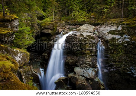 Nooksack Falls. Located in the Mt. Baker National Forest, Washington State. The Nooksack River flows through a Pacific Northwest rain forest environment. - stock photo