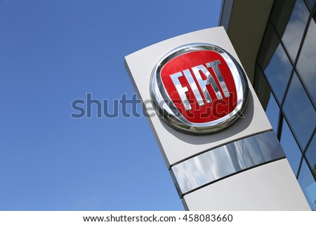 NOORDWIJK, THE NETHERLANDS - July 3, 2016: Fiat dealership sign in front of the showroom. Fiat is the largest automobile manufacturer in Italy. - stock photo