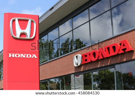 NOORDWIJK, THE NETHERLANDS - July 3, 2016: Honda dealership sign in front of the showroom. Honda is the second-largest Japanese automobile manufacturer.