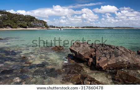 Noosa Heads Stunning Tropical Coastline Landscape Overlooking the Main Paradise Beach With Clouds During Summer, the Tourist Destination, Little Cove, Sunshine Coast, Queensland, Australia - stock photo
