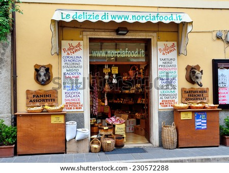 NORCIA PERUGIA UMBRIA,  ITALY, AUGUST 23 - typical and picturesque norcineria shop where they sell meat, sausage, cheese and other food products in the area,  August 23 2014, norcia, umbria italy - stock photo