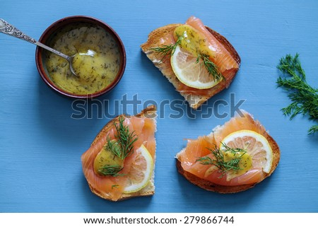 Nordic open sandwiches with salmon and mustard and dill sauce - stock photo