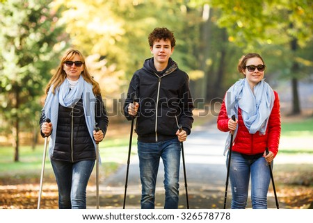 Nordic walking - active people working out  - stock photo