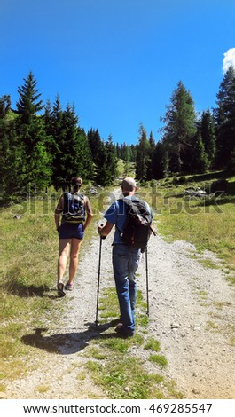 nordic walking in a forest path