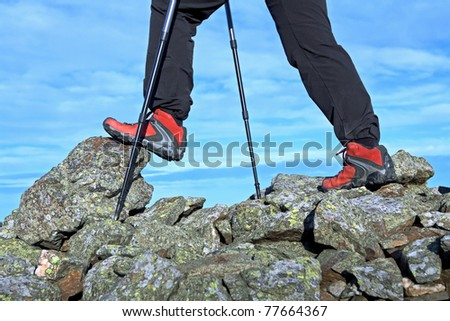 Nordic Walking in Autumn mountains, exercise outdoors - stock photo