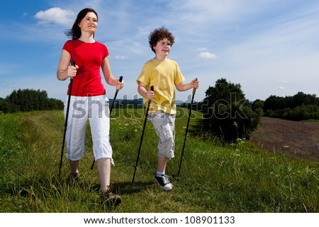 Nordic walking - mother and son outdoor