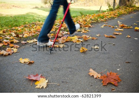 Nordic walking race on autumn trail - motion blur