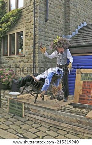NORLAND , UK - SEPTEMBER 5, 2014: Sweeny Tood. The Norland Scarecrow Festival in West Yorkshire, is now in its 15th year and this year the scarecrow trail takes its theme from musicals.