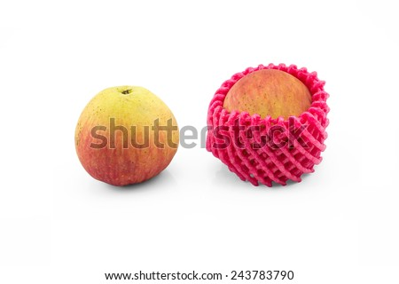 normal apple and apple with foam protection net on isolated white background - stock photo