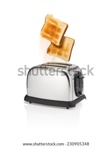 Normal roasted bread slices is flying out from toaster with motion blur. - stock photo