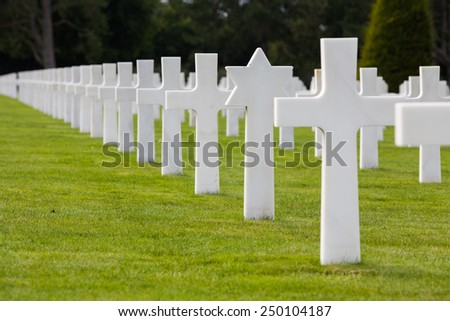NORMANDY AMERICAN CEMETERY, COLLEVILLE-SUR-MER, FRANCE - AUGUST 23: View to the American Memorial cemetery in Normandy on August 23, 2014. It honours American troops who died during World War 2.