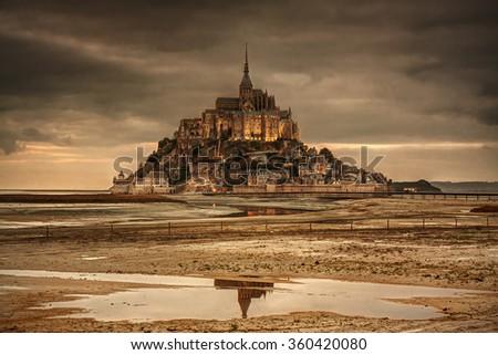 Normandy, France: beautiful Mont Saint-Michel island at sunset. - stock photo