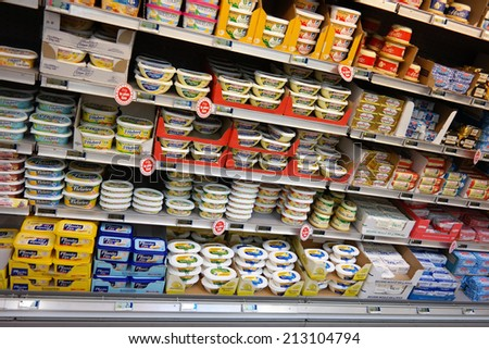 NORMANDY, FRANCE - JULY 23: Refrigerated shelves of butter and margarine at a Carrefour Hypermarket, European dairy products are blocked by a trade embargo by Russia, on July 23, 2014 Normandy, France - stock photo