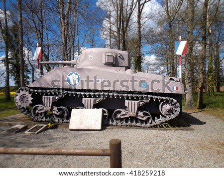 NORMANDY, FRANCE - MAY 5. This Sherman tank is situated beside the road in Normandy to commemorate the allied landings in Normandy in 1944 on May 5th, 2016. - stock photo