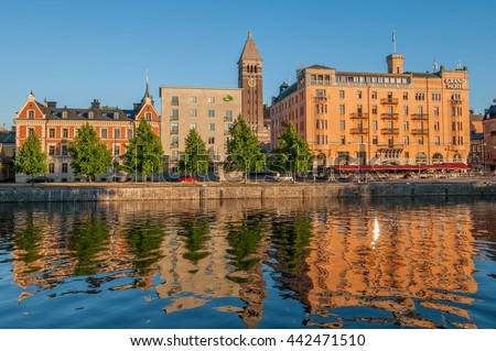 NORRKOPING, SWEDEN - JULY 14: A sunny summer evening by Motala river waterfront on July 14, 2010 in Norrkoping. Norrkoping is a historic industrial town.