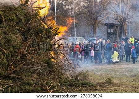 NORRTALJE - APR, 30, 2015: The traditional Walpurgis (Valborg) at Haverodal with crowd warming at the fire. April 30, 2015, Norrtalje, Sweden. Tradition in the Nordic countries to welcome the spring. - stock photo