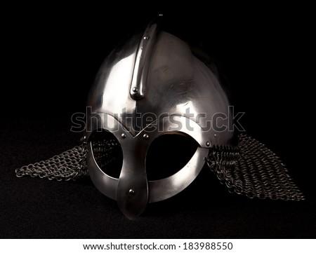 Norsemen helmet on black background. Mesh on both sides. - stock photo