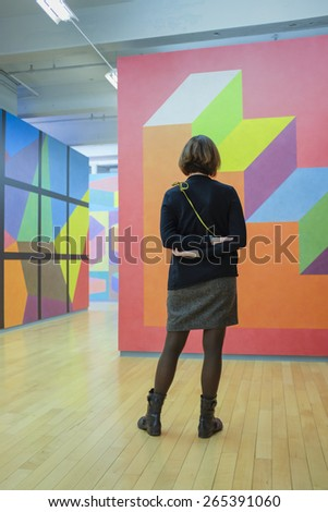 NORTH ADAMS, MA  MARCH 18th: Woman looking at modern art at MassMoCA art museum in North Adams, MA on March 18th, 2015 - stock photo