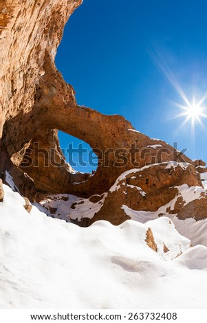 North africa geological wonder: the great hole of Akhiam in winter season. Agoudal, Morocco, Africa. - stock photo