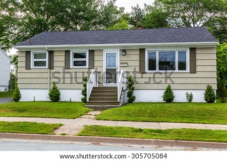 North American bungalow from the sixties or seventies. - stock photo