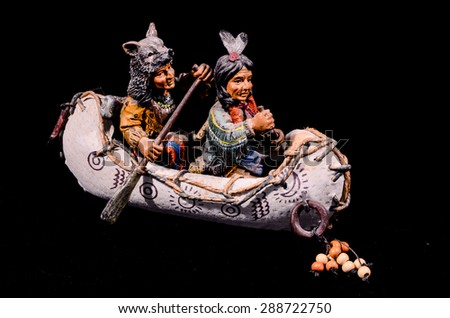 North American Indian Canoe Statue on a Black Background