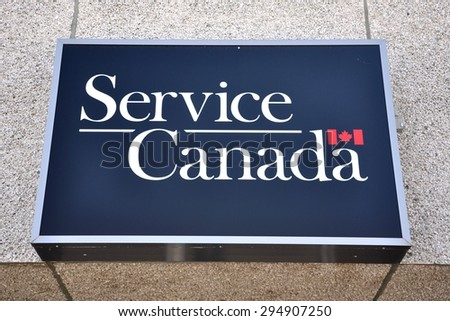 North Bay, Ontario, Canada - June 7, 2015: Service Canada sign in front of the building in North Bay. - stock photo