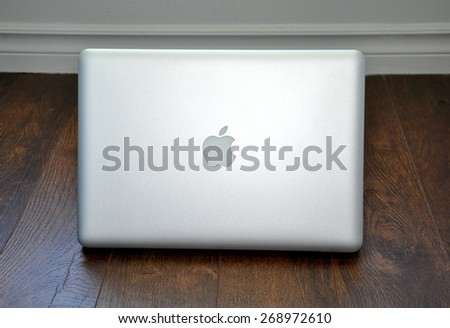 North Bay, Ontario, Canada - March 29, 2015: Logo of Apple in MacBook Pro laptop. - stock photo