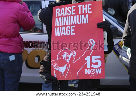 NORTH BERGEN, NEW JERSEY - NOVEMBER 28 2014: WalMartstrikers allied with the Teamster, RWDSU & other unions protested in the parking lot of a New Jersey Walmart for better wages for WalMart workers - stock photo