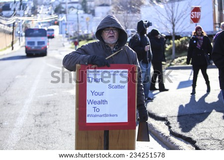 NORTH BERGEN, NEW JERSEY - NOVEMBER 28 2014: WalMartstrikers allied with the Teamster, RWDSU & other unions protested in the parking lot of a New Jersey Walmart for better wages for WalMart workers