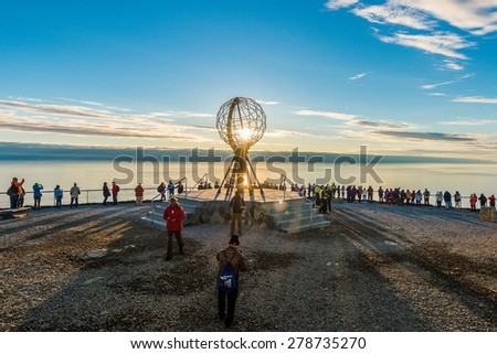 NORTH CAPE, NORWAY - JUNE 30, 2014: People visiting North Cape (Nordkapp), on the northern coast of the island of Mager�¸ya in Finnmark, Northern Norway. - stock photo