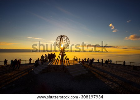 NORTH CAPE, NORWAY - JUNE 30, 2014: People visiting North Cape (Nordkapp), on the northern coast of the island of Mager���¸ya in Finnmark, Northern Norway. - stock photo