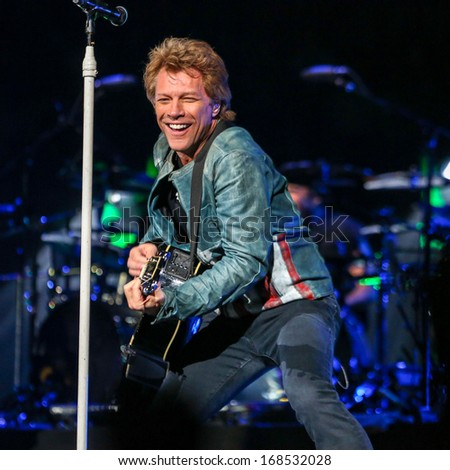 "North Carolina - November 6, 2013 - Bon Jovi performs live in concert as part of their ""Because We Can"" 2013 World Tour. - stock photo"