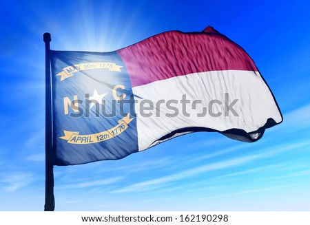 North Carolina (USA) flag waving on the wind - stock photo