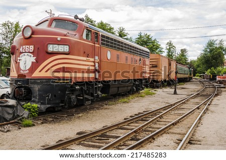 NORTH CONWAY - JULY 24: old fashioned locomotive in a train depot on July 24, 2014 in North Conway, NH, Usa