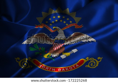 North Dakota flag on satin texture. - stock photo