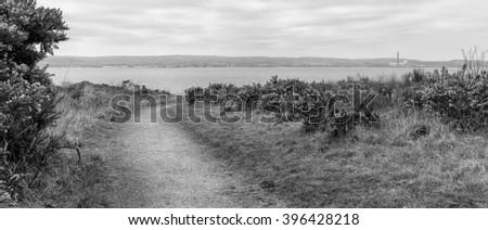 North Down Coastline, Northern Ireland. Rocks, sand and the shore between Belfast and Bangor. - stock photo