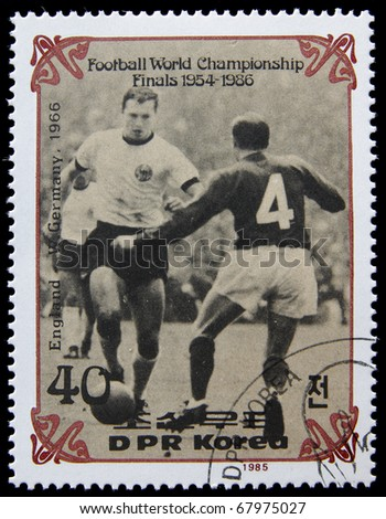 NORTH KOREA - CIRCA 1985:A post stamp printed in North Korea shows football players, devoted football world championship, series, circa 1985. - stock photo
