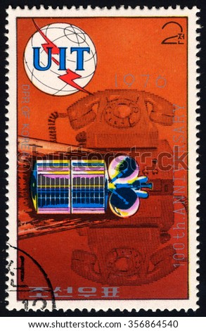 NORTH KOREA - CIRCA 1976: A stamp printed in DPR Korea dedicated to 100th Years of UIT shows Satelite & Telephone, circa 1976 - stock photo