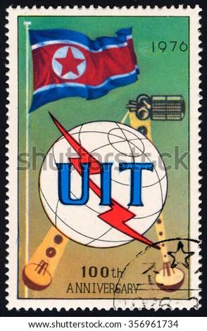 NORTH KOREA - CIRCA 1976: A stamp printed in DPR Korea dedicated to 100th Years of UIT shows Satelite & Satellite dish, circa 1976 - stock photo