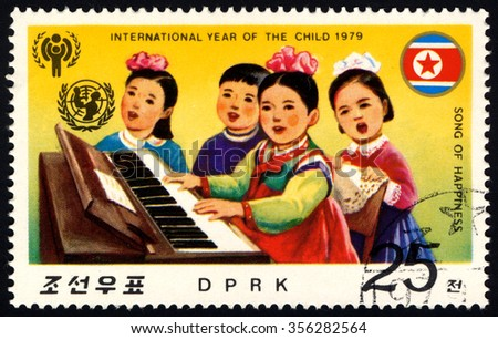 NORTH KOREA - CIRCA 1979: A stamp printed in DPRK dedicated to International year of the Child (II) shows Children Playing Piano & Singing Song â?? Song of Happiness, circa 1979 - stock photo