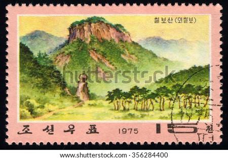 NORTH KOREA - CIRCA 1975: A stamp printed in North Korea dedicated to Chilbo Mountains shows Suri Peak, circa 1975 - stock photo