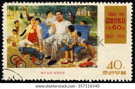 NORTH KOREA - CIRCA 1972: A stamp printed in North Korea dedicated to 60th Birthday of Leader Kim Il Sung shows Kim Il Sung & Children, circa 1972 - stock photo