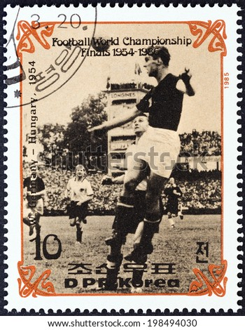 "NORTH KOREA - CIRCA 1985: A stamp printed in North Korea from the ""Football World Cup Finals 1954-1966 "" issue shows West Germany v. Hungary, 1954, circa 1985.  - stock photo"