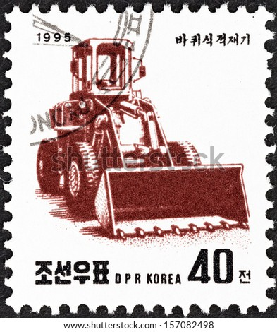 """NORTH KOREA - CIRCA 1995: A stamp printed in North Korea from the """"Machines """" issue shows Earth mover, circa 1995. - stock photo"""