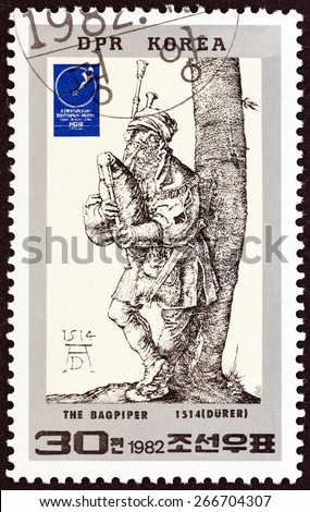 NORTH KOREA - CIRCA 1982: A stamp printed in North Korea issued for the 4th Essen International Stamp Fair shows The Bagpiper (Durer), circa 1982.