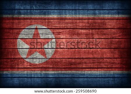 North Korea flag pattern on wooden board texture ,retro vintage style - stock photo